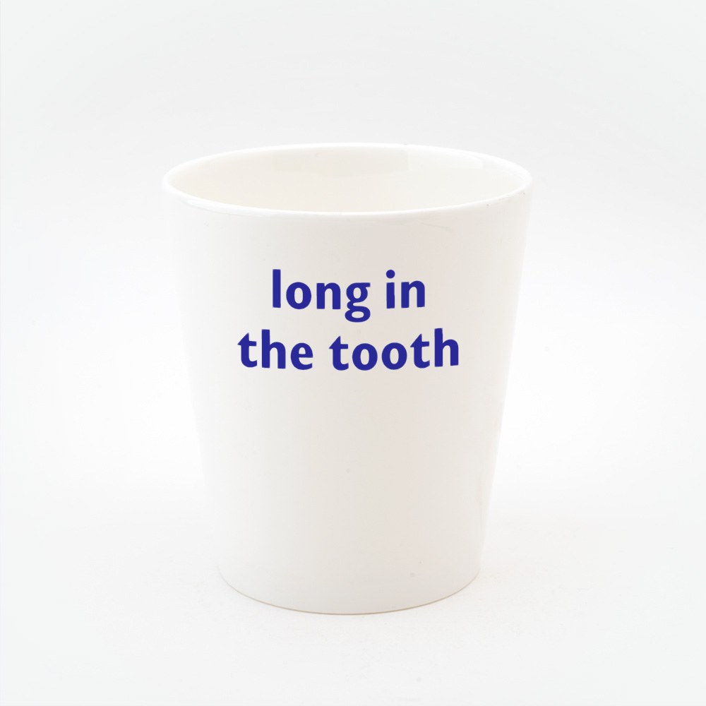 Long in the tooth toothbrush holder